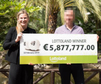 German LottoLand winner collects jackpot check