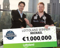 German scratchcard winner Michael collects 1 million Euro cheque